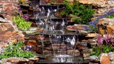 Garden water cascade tilt down — Stock Video