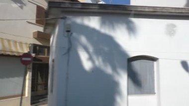 Small Greek town view through bus window — Stock Video