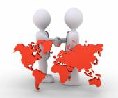Businessmen agree and the world map — Stock Photo