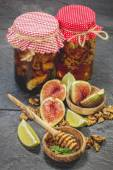 Honey with nuts and dried fruit — Stock Photo