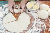 Baker making mini croissants — Stock Photo