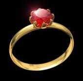 Golden ring with ruby gem isolated on black — Stock Photo