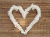 The heart of furry on the wooden surface — Stock Photo