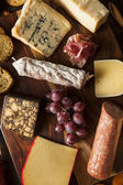 Fancy Meat and Cheeseboard with Fruit — Stock Photo