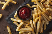 Unhealthy Baked Crinkle French Fries — Stock Photo