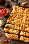 Homemade Cheesy Breadsticks with Marinara — Stock Photo