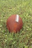 American football ball on a grass. — Stock Photo