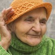 Elderly woman holding hand close to an ear. — Stock Photo #54829675