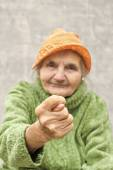 Elderly woman showing fig sign. — Stock Photo
