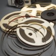Still life of 8mm cine film reels and old movie camera. — Stock Photo #59901561