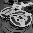 Still life of 8mm cine film reels and old movie camera. — Stock Photo #60925851