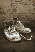 Old black leather shoes. — Stock Photo