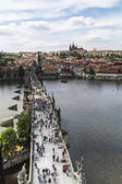 PRAGUE, CZECH REPUBLIC - MAY 2015: People walking on the Charles — Stock Photo