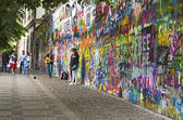 PRAGUE, CZECH REPUBLIC - May 21, 2015: John Lennon Wall with uni — Stock Photo
