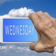 Smart phone in old hand with days of the week -  Wednesday on sc — Stock Photo #78453042