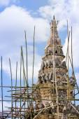 Renovation of old pagoda with wooden scaffolding. — Stock Photo