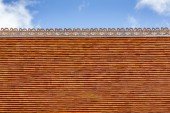 Old style roof tiles  of classic Buddhist temple with sky. — Stock Photo