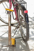 Old air pump and bicycle tire. — Stock Photo