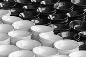 Stack of black and white plates in warehouse. — Stock Photo