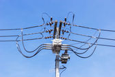 Pile of electrical wiring on blue sky. — Stock Photo