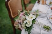 Bridal bouquet on the table — Stock Photo
