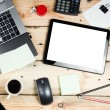 Workplace, laptop and tablet pc on wooden table — Stock Photo #54622627