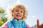Portrait of cute blonde little girl playing outdoors — Stock Photo
