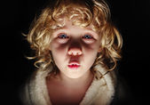 Portrait of cute girl looking at camera with frightening express — Stock Photo