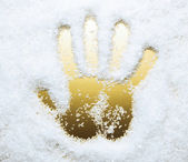 Hand print in artificial snow, golden color — Stock Photo
