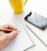 Writing notes or planning a schedule on blank spiral notebook — Stock Photo