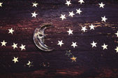 Glitter golden stars and glass moon on grunge wood background. H — Stock Photo