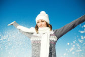 Happy young woman have fun and enjoy fresh snow at beautiful win — Stock Photo