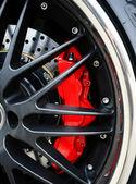 Brake Disc and Red Calliper, Racing Car wheel close up — Stock Photo