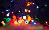 Christmas lights on dark background. Decorative garland. Tinted  — Stock Photo