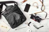 Objects on wooden background: leather bag, camera, smartphone, k — Stock Photo