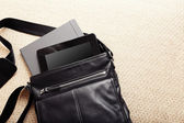 Modern man accessories. Things from open bag — Стоковое фото
