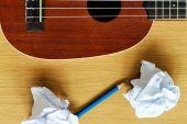 Ukulele guitar with paper scraps and pencil — Foto de Stock