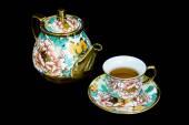 Chinaware tea pod and small drinking bowls — Stock Photo
