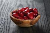Ripe cornel berrys in bowl — Stock Photo