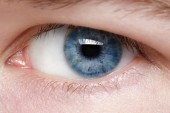 Blue eye of young man — Stock Photo