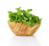 Bunch of fresh mint in wood bowl — Stock Photo