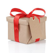 Gift box wrapped with kraft paper and red bow — Stock Photo