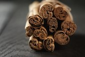 Bunch of cinnamon sticks tied with twine — Stock Photo