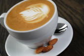 Cup of fresh cappuccino with latte art — Stock Photo