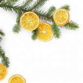 Spruce twig with dried orange slices on white background — Stock Photo
