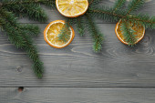 Spruce twig with dried orange slices — Stock Photo