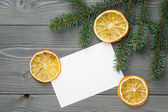 Spruce twig with dried orange slices and greeting card — Stockfoto