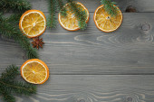 Spruce twig with dried orange slices and anise — Stock Photo
