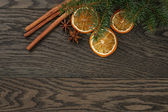 Christmas background with cinnamon anise and oranges — Stock Photo