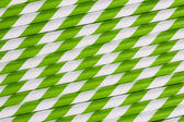 Bright green paper straw background — Stock Photo